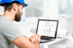 Architect working with laptop at the structure interior Royalty Free Stock Photos