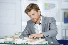 Architect working on model stock images