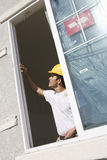 Architect Working Near Window stock images