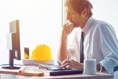 Architect and construction engineer working in office. Architect working in office, construction engineer working with desktop pc computer making a construction Royalty Free Stock Photo