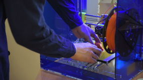 Architect working in office creating models for project using 3D printer. stock video footage