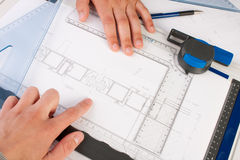 Architect Working On Architectural Plans Royalty Free Stock Image