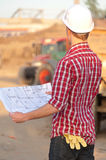 Architect working outdoors on a construction site. Young architect working outdoors on a construction site stock photography