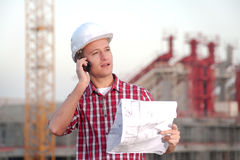 Architect working outdoors on a construction site Royalty Free Stock Image