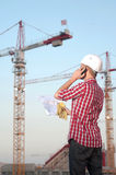 Architect working outdoors on a construction site. Young architect working outdoors on a construction site stock photos