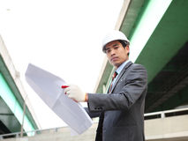 Architect   working on planning. Architect  with blueprint on highway construction site Stock Images