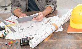 Architect working on plans. At office stock photos