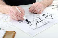 Architect working on plans Stock Image