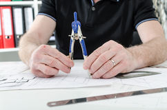 Architect working on plans Royalty Free Stock Photography