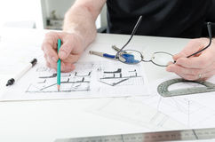 Architect working on plans Royalty Free Stock Photos
