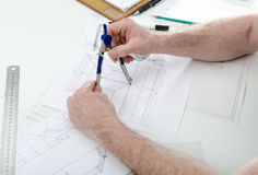 Architect working on plans Stock Image