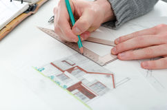 Architect working on plans Royalty Free Stock Photo