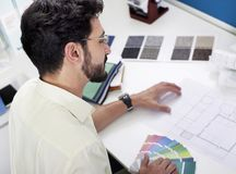 Architect working on project. Architect working on blueprints from above Stock Images