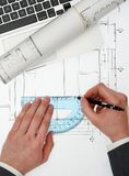 Architect working on project. Architect working on blueprints from above Royalty Free Stock Photography