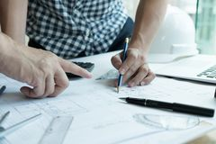 Architect working on real estate project with partner at workpla Royalty Free Stock Photo