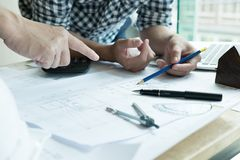 Architect working on real estate project with partner at workpla Royalty Free Stock Photography