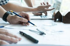 Architect working on real estate project with partner at workpla Royalty Free Stock Photos