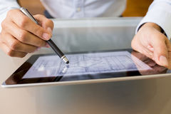 Architect working with stylus and digital tablet pc Stock Image