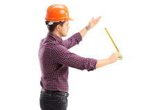 An architect working with a tape measure Royalty Free Stock Photography
