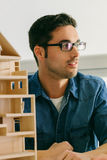Architect working on a wooden model Royalty Free Stock Images
