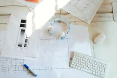 Architectural project, blueprints, blueprint rolls on wooden desk table stock images