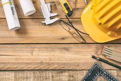 Free Architect Workplace. Project Construction Blueprints And Engineering Tools On Wooden Desk, Copy Space Stock Photo - 117087570