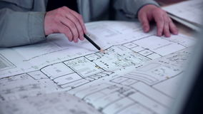Architect works  with blueprint. stock video
