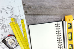 Architect workspace with blueprint, tools, notepad and pencil Royalty Free Stock Image