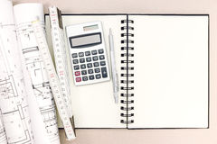 Architect workspace with blueprints, notepad, folding rule Royalty Free Stock Images
