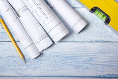 Architect worplace top view. Architectural project, blueprints, blueprint rolls on wooden desk table. Construction Royalty Free Stock Photo
