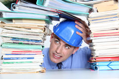An architect worry about paperwork. An architect worry about his paperwork Stock Photo