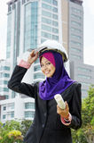 An architect Young Muslim women. An architect Young Muslim woman at work Royalty Free Stock Images