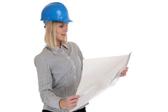 Architect young woman reading plan woman occupation job isolated. On a white background Stock Photos