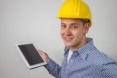 Architecte avec un PC de comprimé Photo libre de droits