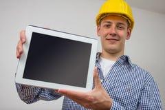 Architecte avec un PC de comprimé Photo stock