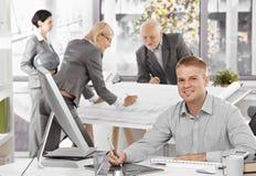 Architecten bezig op het werk Stock Foto's
