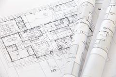 Architectenbroodjes en plannen Stock Foto's