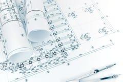 Architectenwerkruimte met projectplannen, gerolde blauwdrukken en D Royalty-vrije Stock Afbeeldingen