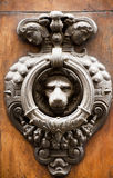 Architectonic and design element. old doorknocker. An ancient doorknocker in the city of Florence Stock Photo