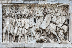 Architectonic detail of arch of Constantine in Rome. Personal cavalry of the emperor commanded by Trajan and conquering barbarians, the frieze of arch of Stock Photos