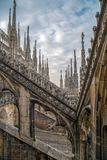 Architectonic details of the Milan Cathedral. Architectonic details from roof of the famous Milan Cathedral, Lombardy, Italy. Famous spire Stock Image