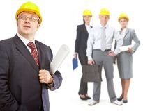 Architects. Collage of confident architects in helmets with their leader in front royalty free stock image