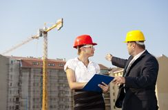 Architects are agreed on a plan to build a building Stock Photo