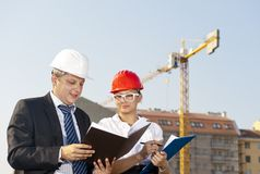 Architects are agreed on a plan to build a building Royalty Free Stock Image