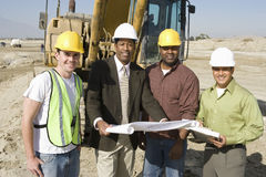 Architects With Blueprint At Construction Site Royalty Free Stock Photo
