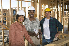 Architects With Blueprint At Construction Site Stock Photo