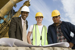 Architects With Blueprint At Site Stock Image