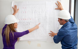Architects with blueprints Royalty Free Stock Images