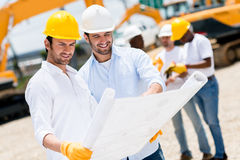 Architects at a building site Stock Photos