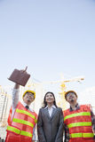 Architects and businesswoman at a construction site, Beijing Stock Images